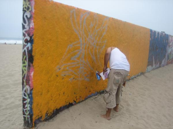 Grafitti art is a culture celebrated in L.A. This has a permit to start a new mural on Venice Beach.
